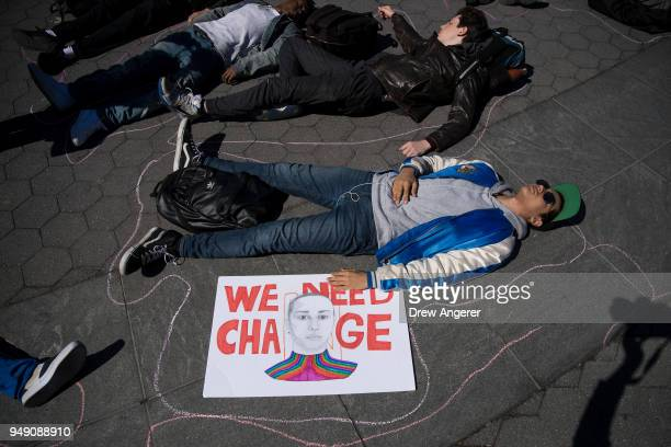Student activists participate in a 'die-in' to protest gun violence at Washington Square Park, near the campus of New York University, April 20, 2018...