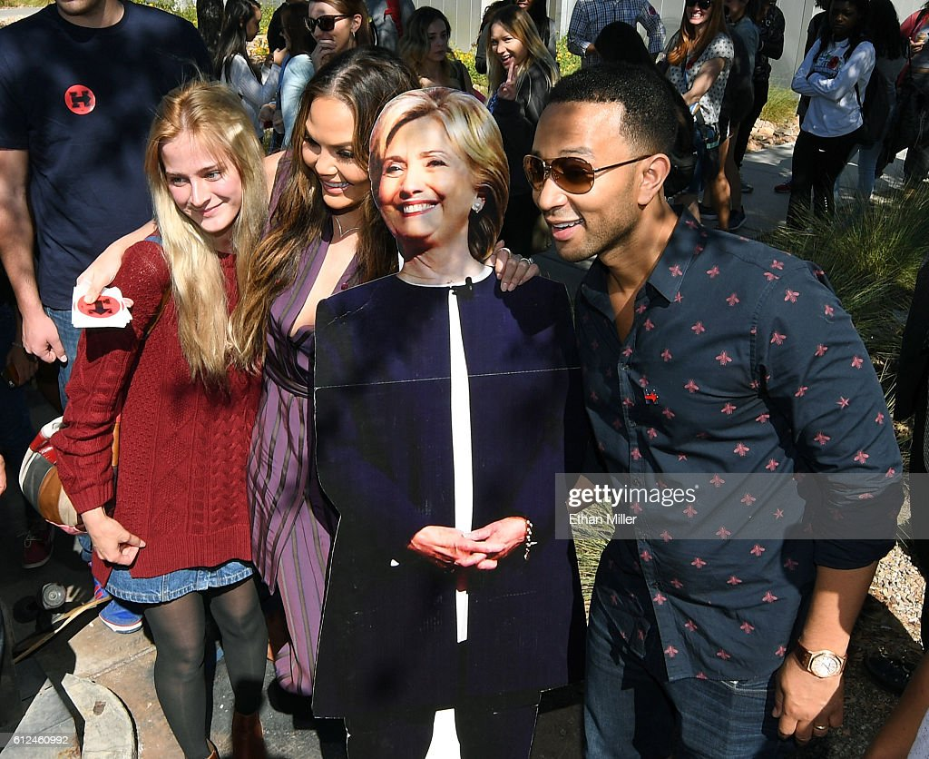 UNLV student Alexandra Olianna (L) poses with model and television personality Chrissy Teigen (2nd L), singer/songwriter John Legend (R) and a cardboard cutout of Democratic presidential nominee Hillary Clinton during a voter registration drive at UNLV on October 4, 2016 in Las Vegas, Nevada.