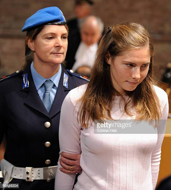 US student Amanda Knox accused of taking part in the killing of her British roommate Meredith Kercher two yearsago is escorted by a policeman as she...