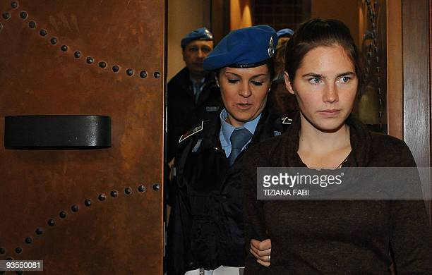 US student Amanda Knox accused of taking part in the killing of her British roommate Meredith Kercher in 2007 is escorted as she arrives for her...