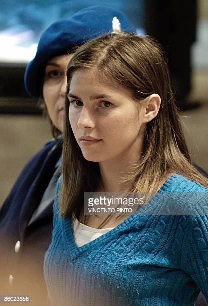 US student Amanda Knox charged with the alleged sexmurder of her British housemate in the Italian university town of Perugia leaves the courtroom in...