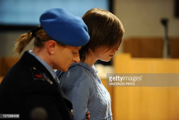 US student Amanda Knox is escorted into the Perugia courthouse for the start of her appeal trial on November 24 2010 Knox was sentenced to 26 years...