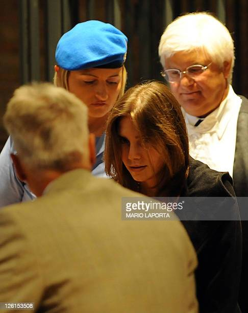 US student Amanda Knox speaks with her lawyer Carlo Della Vedova in court on September 23 2011 as her appeal trial against her conviction for the...