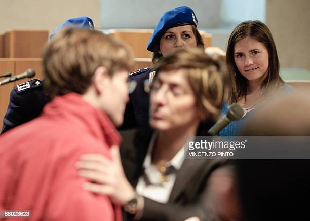 US student Amanda Knox views Raffaele Sollecito greeted by her lawyer Giulia Mezzogiorno in the court of Perugia at the end of a trial session on...
