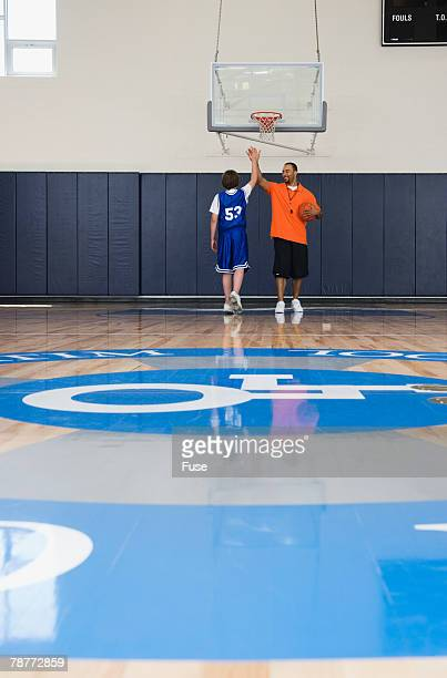 Student and Coach on Basketball Court