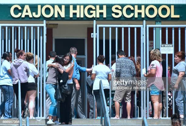 A student and her mother embrace one another upon leaving Cajon High School in San Bernardino California on April 10 where parents of children from...