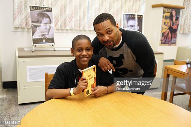 A student and Michael Epps attend the Michael and Mechelle Epps Foundation Media Day at the Crispus Attucks Medical Magnet High School on February 3...