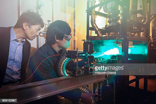 Student and Professor Experimenting with Lasers