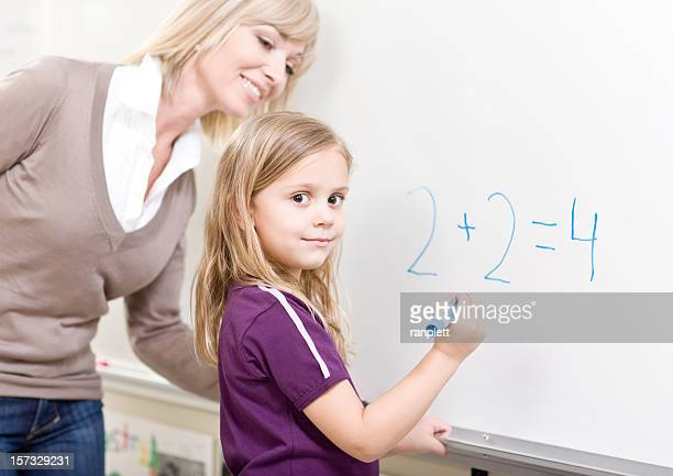 Student and Teacher doing Math