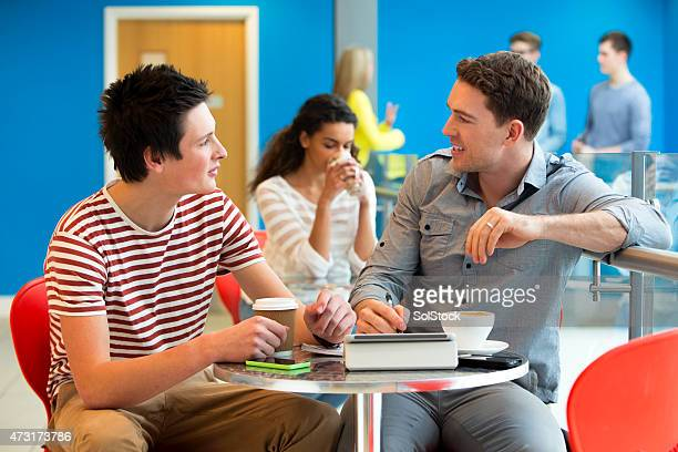 Student and Tutor Meet in a  Cafe