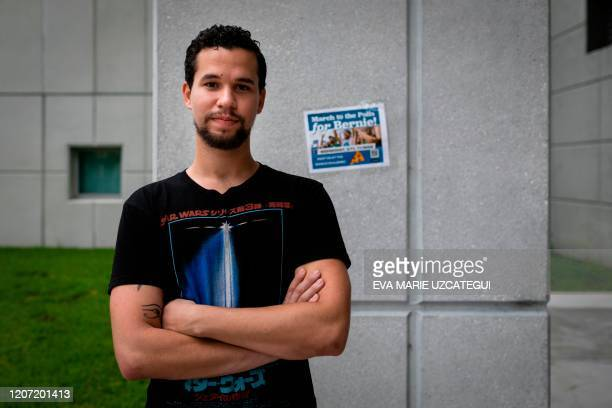 Student Andy Vila, a cuban supporter of US Democratic presidential candidate Senator Bernie Sanders, poses for a photo at Florida International...