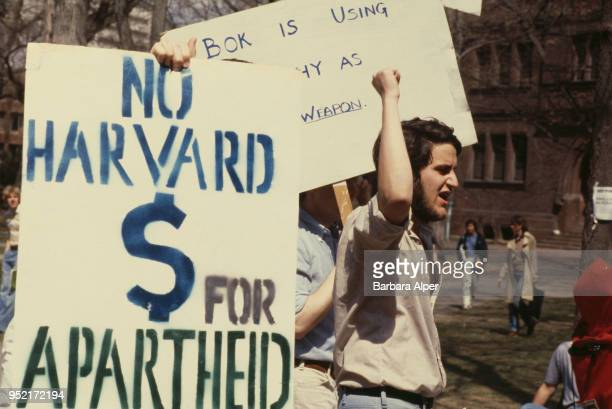 Student antiApartheid protesters with placards urging Harvard University to divest itself of investments in South Africa Cambridge Massachusetts 23rd...