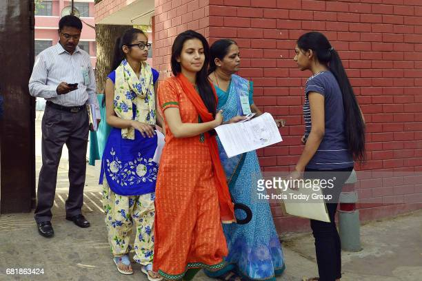 Student appearing for the NEET exam being frisked before entering the examination center in New Delhi