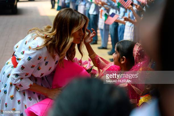 TOPSHOT A student applies vermilion powder on the forehead of US First Lady Melania Trump as she arrives at Sarvodaya CoEd Senior Secondary School in...