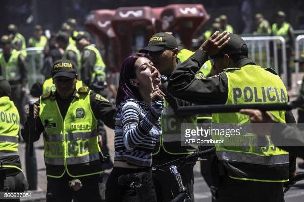 TOPSHOT A student argues with police in Medellin Colombia on October 12 2017 during a protest in the framework of a general strike / AFP PHOTO /...