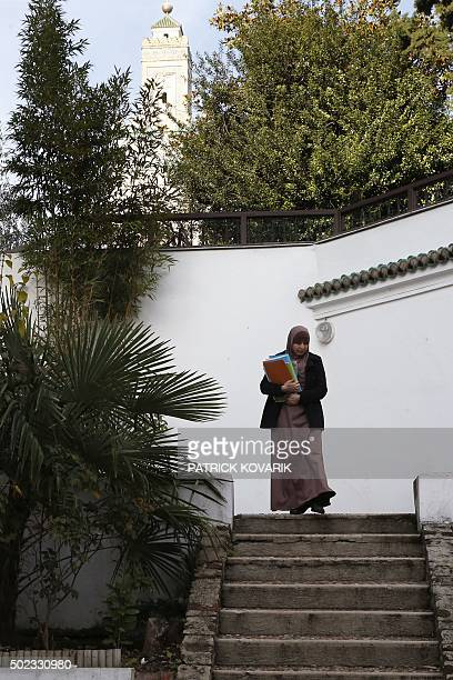 A student arrives to follow a theology training class for futur imams and clerics at the AlGhazali institute of the Grand Mosque of Paris on December...