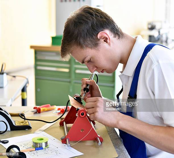 student assembling circuit board - mechatronics stock pictures, royalty-free photos & images