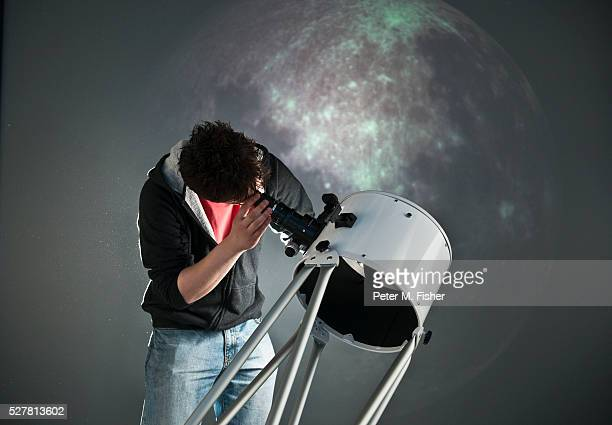 Student astronomer looking through a telescope