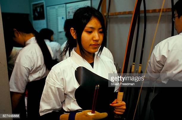 A student at a Kyudo dojo Kyudo is a modern Japanese martial art derived from ancient Samurai archery and heavily influenced by Zen Buddhist...