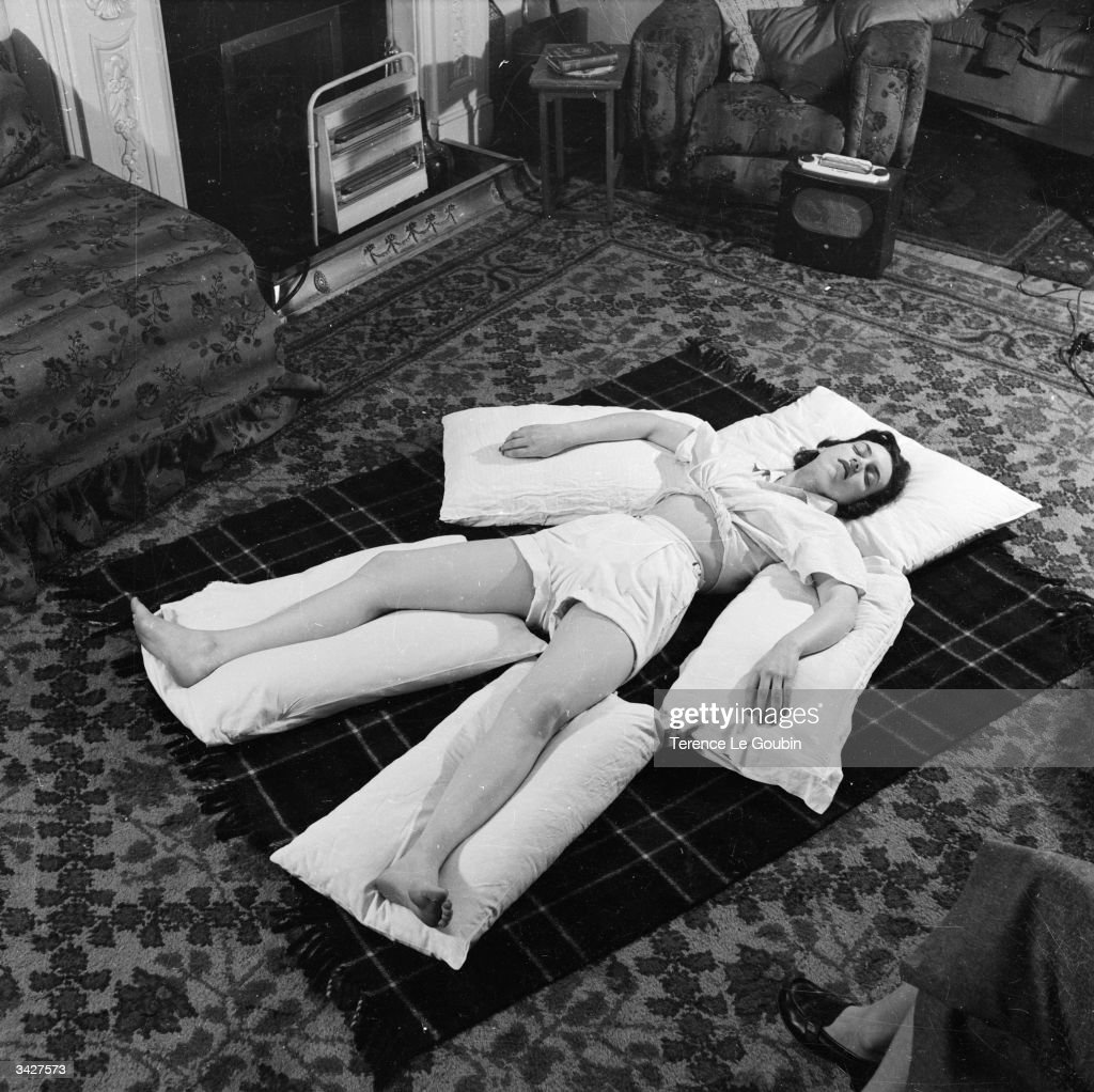 A student at a London hospital learns how to fully relax under the tuition of Mary Phillips of the Chartered Society of Physiotherapists.