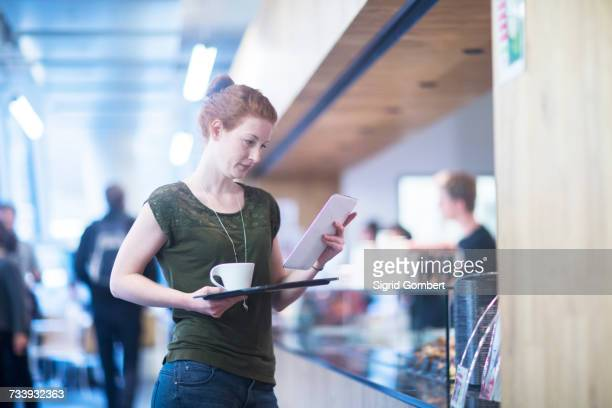 Student at cafe in library