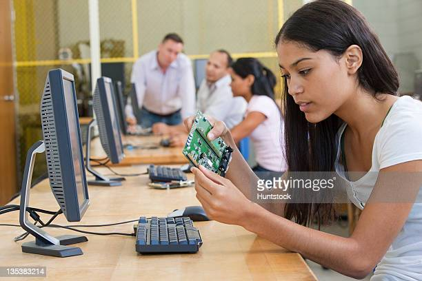 Student at computer using microcontroller board