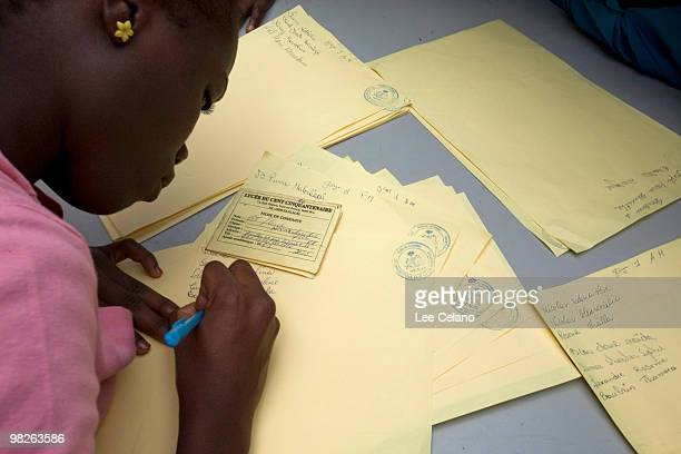 A student at Lycee du Cent Cinquantenaire fills out registration material April 5 2010 in PortauPrince Haiti The school is set to open with temporary...