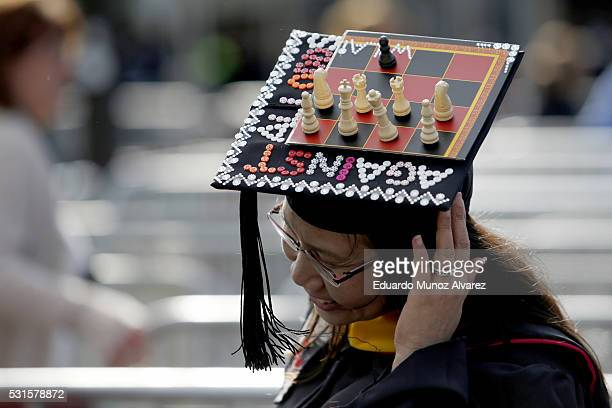 A student at Rutgers University shows her cap as she arrives to attend the 250th anniversary commencement ceremony on May 15 2016 in New Brunswick...