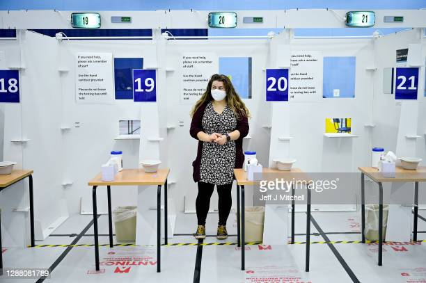 A student at St Andrew University participates in testing of a lateral flow antigen test facility before its opening at the weekend on November 27...