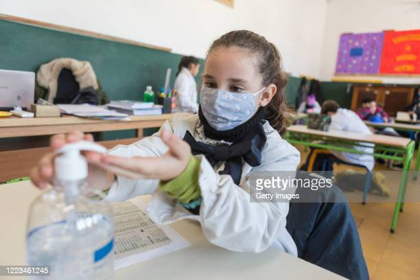 """Student at the """"Japon"""" public school number 72 uses hand sanitizer during class during the first day of the final phase of the gradual process to..."""