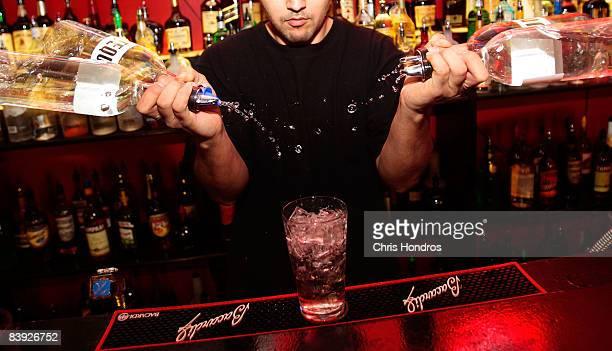 A student at the New York Bartending School pours a Long Beach Iced Tea drink December 5 2008 in New York City Enrollment is up at the bartending...