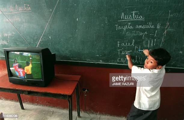A student at the 'Republica de Paraguay' elementary school in Lima tabulates on the blackboard the number of fouls committed by the Austrian national...