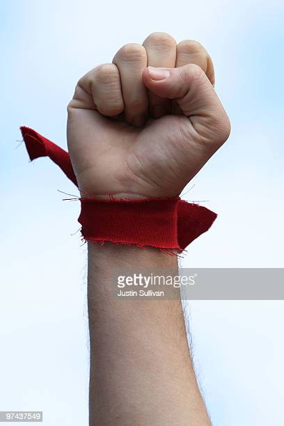 Student at UC Berkeley wears a red band on his arm as he blocks Sather Gate while demonstrating during a national day of action against funding cuts...