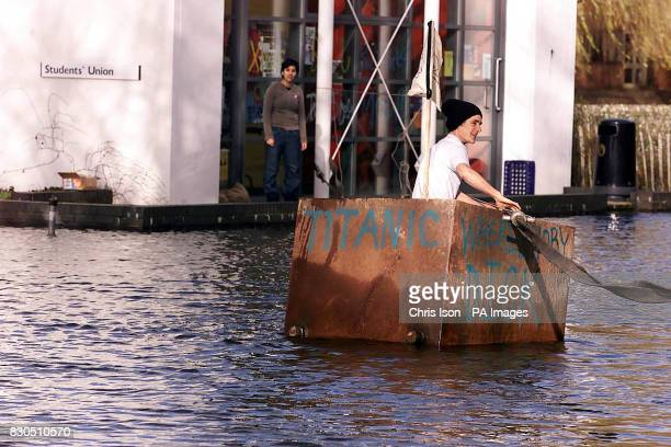 A student at Winchester School of Art finds an inventive way of battling through the floods after heavy rain left parts of the campus under water