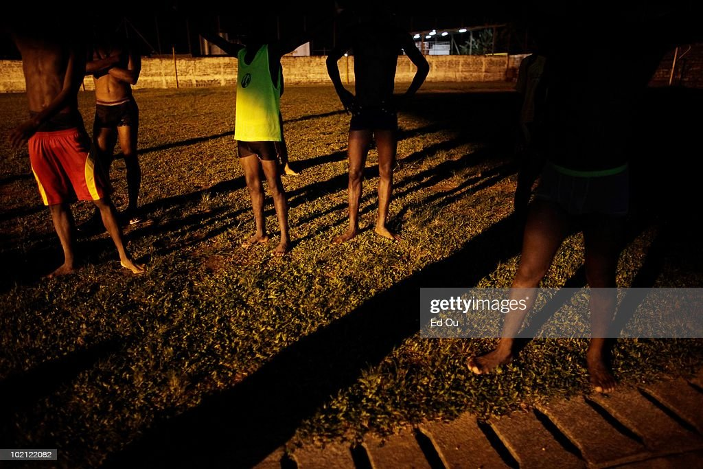 Student athletes from the l'�cole de soccer des Brasseries Cameroun stretch and warm up after a match, May 26, 2010 in Douala, Cameroon. The students in the soccer academy spend their days training and studying.