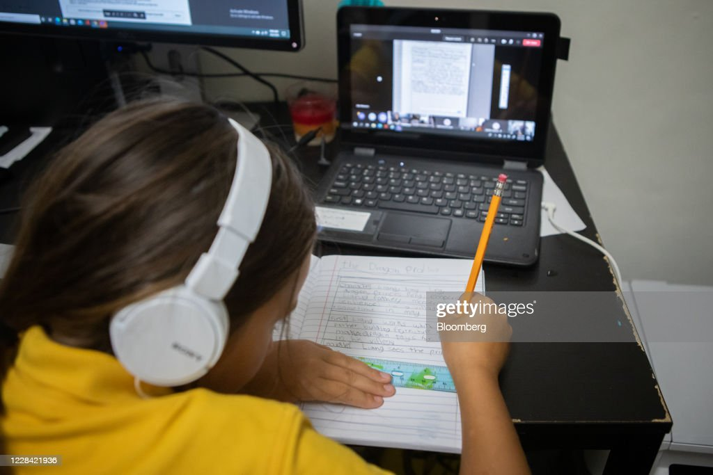Working From Home And Learning Remotely As Cases Drop In Florida : News Photo