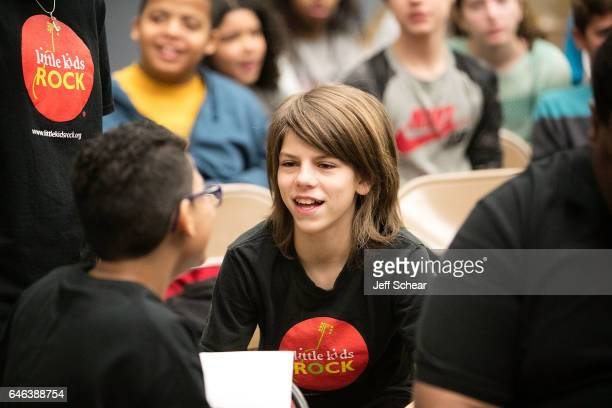 A student attends as Chicago Public School Announces Music Program Expansion With Little Kids Rock at Franklin Fine Arts Center Auditorium on...