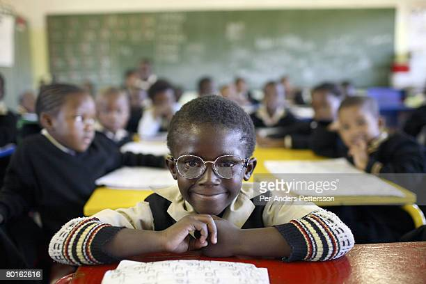 A student attends class in a Primary school on May 10 2007 in Orlando West section of Soweto South Africa Many of the children are poor and live with...
