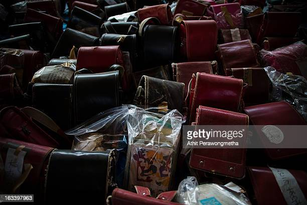 Student bags are collected in a school gymnasuim to support victims as the second anniversary of the earthquake and tsunami is remembered on March 9...