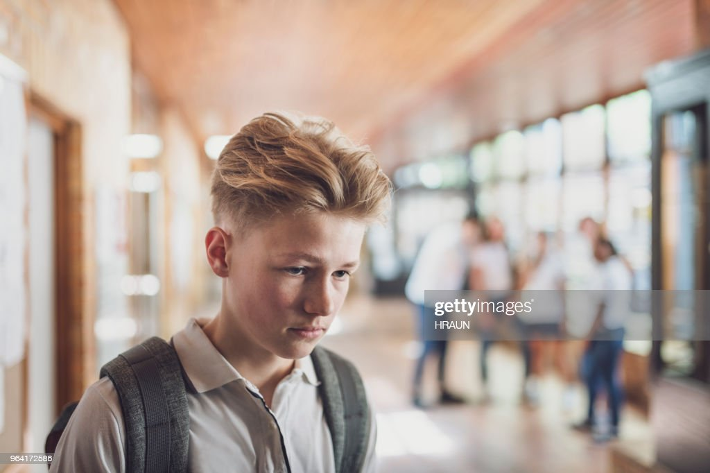 Student being bullied by classmates in school : Stock Photo