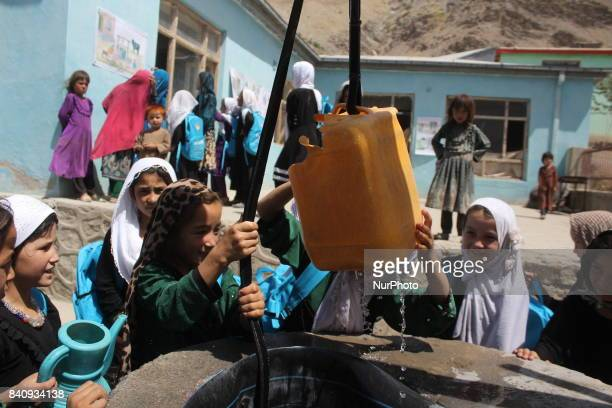 Student boys and girls are drinking water from a well in Urgoon district of Badakhshan province in Afghanistan on 30 August 2017The lack of drinking...