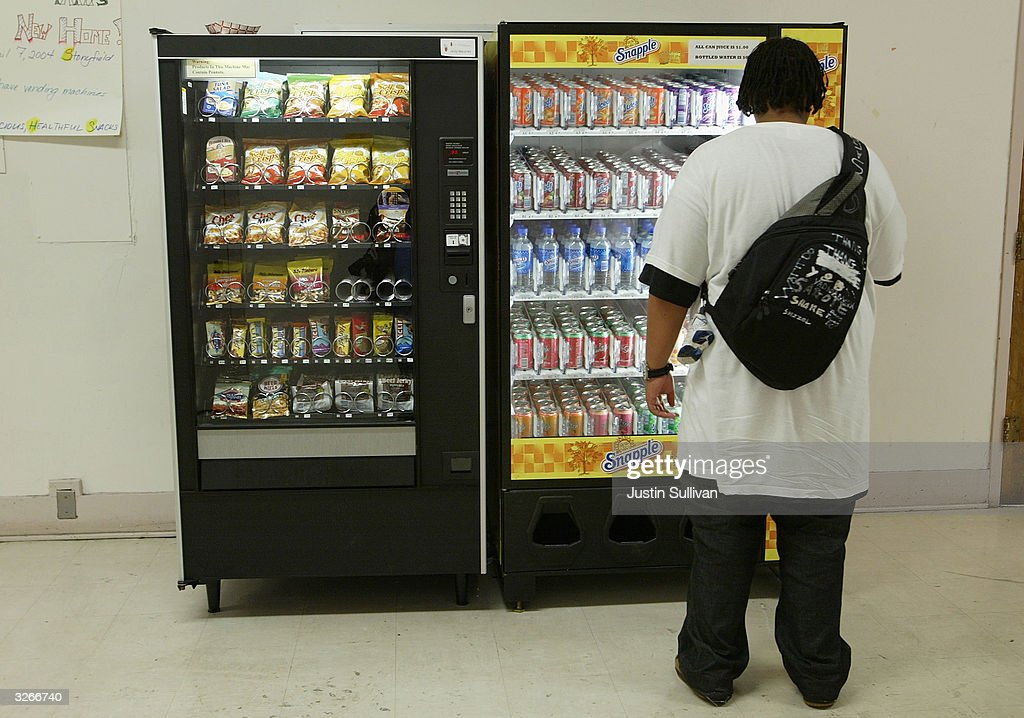 A student buys snacks from a vending machine at Mission High School April 8, 2004 in San Francisco, California. In an effort to battle obesity in children, the San Francisco unified school district is among the first in the nation to introduce healthy vending machines in their schools which feature organic food and juice drinks.