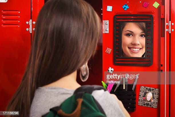 student by a locker - locker stock pictures, royalty-free photos & images