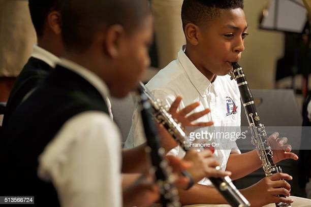 Student Cameron Butler right plays music during a ceremony at Children of Promise Preparatory Academy in Inglewood CA March 3 2016 The school was...