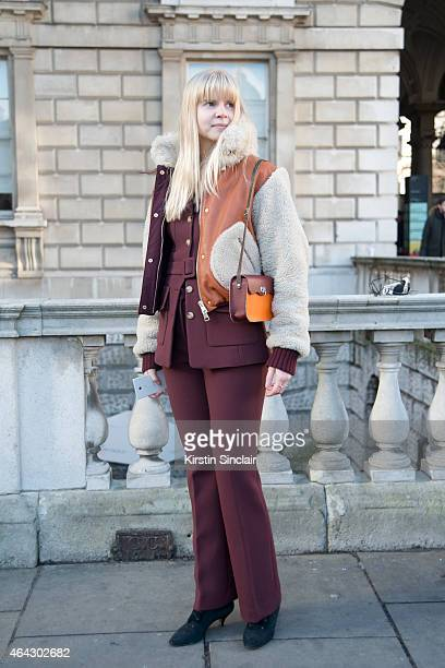 Student Camila Molyneux wears an H and M suit vintage bag and shoes with a Tommy Hilfiger coat on February 21 2015 in London England