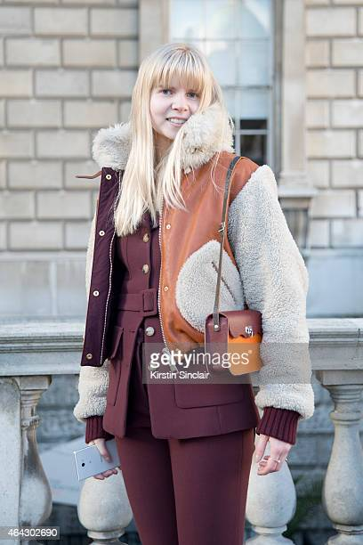 Student Camila Molyneux wears an H and M suit vintage bag with a Tommy Hilfiger coat on February 21 2015 in London England