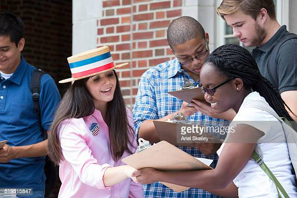 student campaigning at voter registration - petition stock photos and pictures