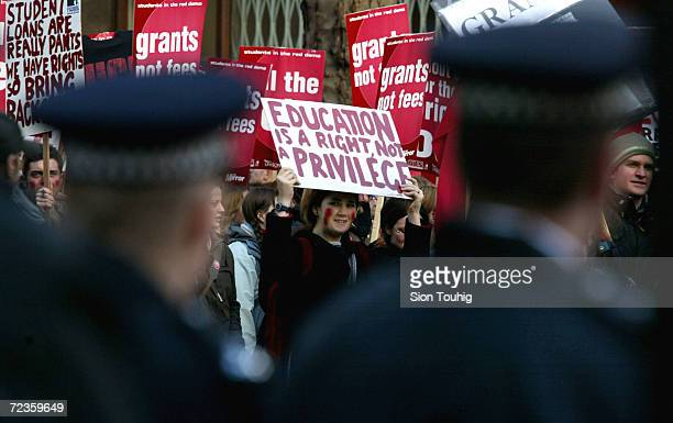 A student carries a banner calling for free education while participating in a demonstration February 20 2002 in London The students are calling for...