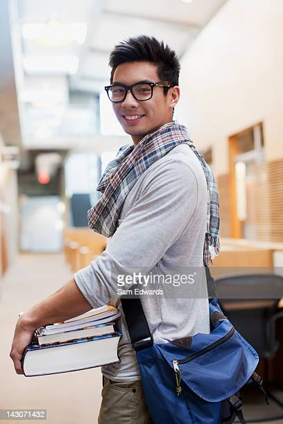 student carrying books in school hallway - 20 24 years stock pictures, royalty-free photos & images