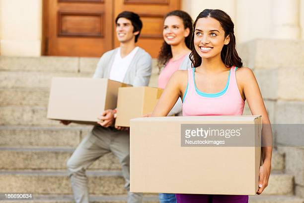Student Carrying Cardboard Box While Looking Away